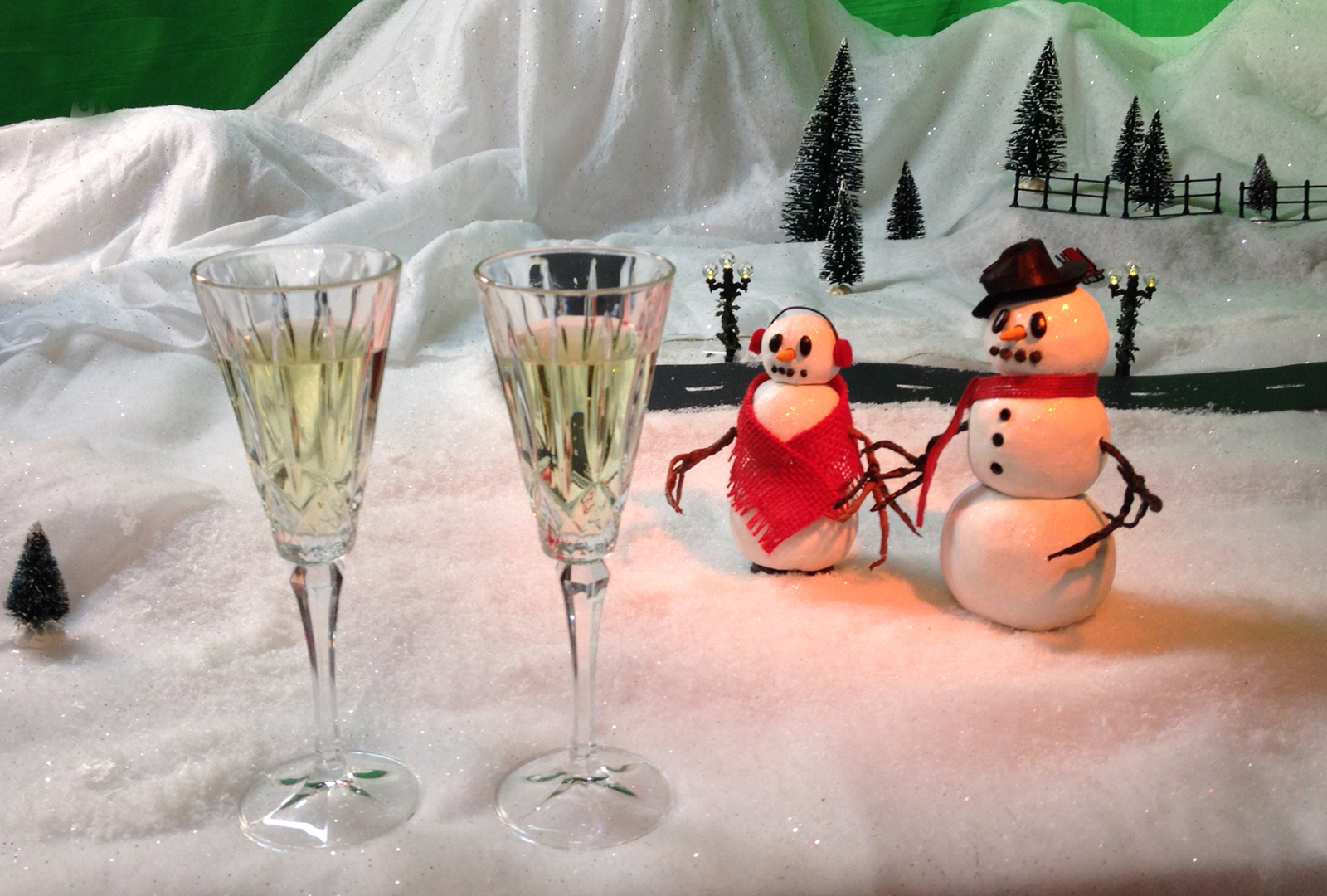Close up of puppets with champagne glasses at the end of the production